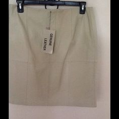Genuine Leather Skirt Bone colored genuine leather skirt. New with tags, size 16M. Skirt has zipper front with button closure and back vent pleat Chadwicks Skirts Pencil