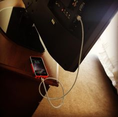 If you forget your wall charger piece, use the USB plug on the back of a TV as a way to charge your phone.