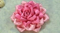 Satin ribbon rose.  Youtube tutorial under http://www.youtube.com/watch?v=HukC7S7uiWY