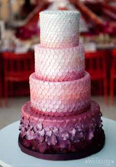 ombre petals on a #pink and #purple wedding cake.... Looks like a purple dragon! Crazy and cool.