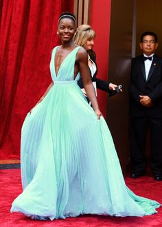 Lupita Nyong'o - best supporting actress at the Oscars 2014; she is so beautiful, poised and graciously humble. Her choice of attire is courageous and makes a big statement also. Definitely a role model!