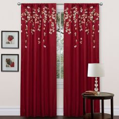 Add a new splash of color to your home and windows with this 84-inch red floral-printed window panel. This panel boasts an embroidered flower motif. Made of faux silk, these rod-pocket window panels will add an interesting design detail to windows.