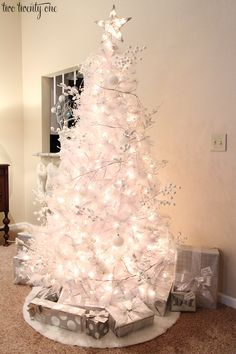 White Christmas Tree Decor - - White Christmas tree with white and silver decorations. White Christmas Tree Decorations, Black Christmas Trees, White Christmas Trees, Ribbon On Christmas Tree, Beautiful Christmas Trees, Silver Christmas, Silver Decorations, Merry Christmas, Christmas Mantles