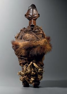 YAKA NKISI STATUETTE  Democratic Republic of Congo  Wood, skin, vegetable fibres (cords and cloth)