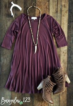 Ultra-Soft Tunic Dress in Soft Wine. Pullover style with slight A-line fit. Add a vest or cardigan and leggings as the weather cools. Great with Fall Booties or Wedges. Shown on model in Olive (size s