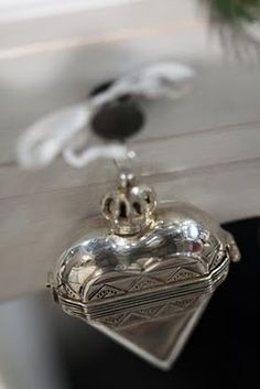 Crowned Heart! This looks like a box ornament. Wonderful.  Silver <3