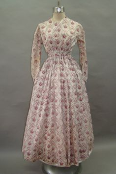 "Darling 1860's Work Day Dress Summer Sheer | eBay seller joannthegreat; pocket on right side, bodice lined, fabric roses in pinks & reds, with black & blue; many period mends in sleeves & skirt; bodice boned; cartridge pleated; back hook & eye closure; Bust: 32""; waist: 24""; skirt length: 35""; circumference: 136"""