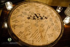 Instead of guests signing a picture board, they sign the top of a wine barrel