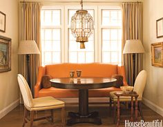 Butternut Orange In a California beach house, designer Chad Eisner used an orange and beige palette to create a cozy bungalow feeling. The dining area has a banquette covered in top-stitched custom-dyed leather from Caldelle, Ltd. Dining Room Windows, Dining Nook, Dining Table Chairs, Fall Color Schemes, Banquette Seating, Cozy Room, Layout, Decoration, Beautiful Homes