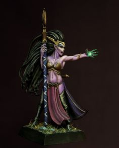 Dark Elf Sorceress painted by przemek, absolutely amazing painting here, all rest of the pics for this model are here: http://www.planetfigure.com/threads/dark-elf-sorceress-nurgle-chaos-lord.45251/