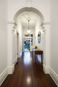 Interior:Surprising Hallway With Charming Chandeliers Also Wooden Vanity Also Mirror On White Walls Also Laminate Flooring Its Home Interior Living Spaces For Modern Family Living In Melbourne Fascination Home Interior Living Spaces: for Modern Family Living in Melbourne