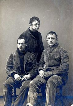 Very young boxers, early 20th century. I find this photo odd because why would they take a picture of three men who are so obviously beaten up?