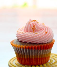 Tequila Sunrise Cupcakes Made these for the first time last night. Frosting ROCKS, but be sure you spray the cupcake liners because these things stick like nobody's business. Also, fill them with more batter than the recipe calls for. Mine were flat.