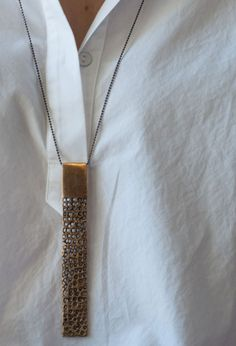Bronze Totem necklace. Add some shine to your classic white shirt. #juliecohndesign