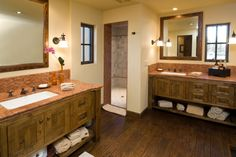 This unique bathroom has an impressive shower built from a small room and natural wooden floors.