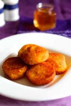 Pampoenkoekies are traditional South African pumpkin fritters that are eaten either sweet with caramel or cinnamon sugar, or savory as an appetizer.