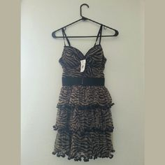 Dress NWT Animal print dress with a built in bra. New with tags. Size Small. bebe Dresses