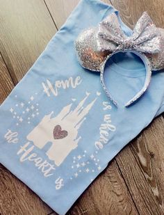 The perfect Tee for anyone who calls Disney Home The Home is where the Heart is Castle Tee is made of black or white iron on vinyl. These shirts are in woman sizes and range from size small to extra large. This shirt comes in pale blue and white. Also a glitter heart is on the shirt as well. Please see size chart for measurements to ensure you picked the proper size shirt. Remember these are woman size shirts. Washing Instructions are to be as followed... Preferred Method • Turn garment i...