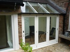 Häfele E3 Bifold Door - Planetherm Bioclean Self Cleaning Glass - Exitex Copex Roof System