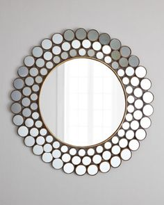"$120 Round accent mirror is framed by three concentric rings of circles, each framing a tiny mirror. Adds light and depth to your modern space. Made of metal and mirrored glass. 31""Dia. Imported. Boxed weight, approximately 13 lbs."