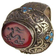 Persian ring :    Circular shaped carnelian with an image of a deer. Original silver setting with inscribed details and turquoise beads.  200 BC