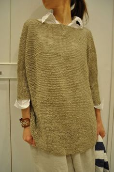 (daniela gregis) loose knit sweater over rumpled linen shirt and bag skirt…