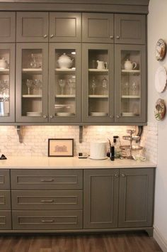 hardwood floors, gray cabinets, white countertops