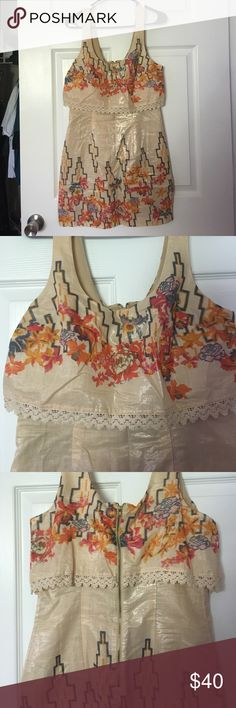 Free people dress Tan free people dress with colored floral designs. Never been work before just took off the tags! Very fitting but adorable on! Free People Dresses