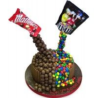 This spectacular chocolate lovers birthday cake with the wow factor is an amazing gravity defying party centrepiece that your guests will defiantly talk and tweet about. Malteesers and M&M 's have never tasted so good.