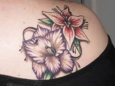 birth flower tattoos for honoring kids | Kids' birth month flowers tattooed on shoulder blade: ... | Tattoo id ...