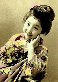 This ca.1905-10 image of a young Geisha (or possibly a Maiko) is a rarity. Actually, it's the SMILE that makes it rare. At this point in Japanese photographic history, only about ONE in ONE-TO-THREE-HUNDRED images of Geisha Girls will be found with a smile.