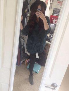 green + black flannel, black leggings black shoes