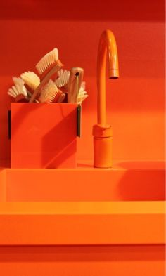 A photograph of an awesome bright orange kitchen sink and faucet. Orange Pastel, Orange Clair, Jaune Orange, Orange Yellow, Burnt Orange, Orange Zest, Orange Kitchen, Power Colors, Orange Aesthetic