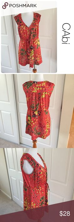 CAbi floral tunic dress size M ♦️Excellent condition. No holes, stains or piling.                                                 ♦️Materials- 100 polyester                      ♦️Measurements:                                                ♦️Laying flat armpit to armpit: approximately 19 inches                       ♦️Laying flat from the back of the neck to the bottom of the front hem is approximately 29inches Tops Tunics