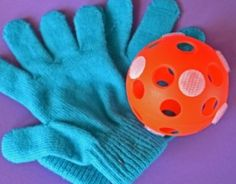 Add several pieces of Velcro to a whiffle ball and have your child put their gloves on and play catch!  It's a great way to focus on hand eye coordination and gross motor skills!