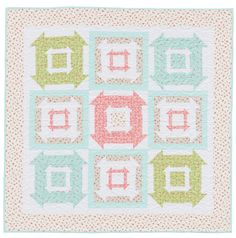 Cheery Double Churn Dash blocks in dreamy pastels - designed by Kimberly Jolly.