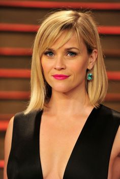 There's no doubt about it: 2014 was the year of The Lob. The shoulder-grazing style cropped up on everyone from supermodel Karlie Kloss to actresses Kristen Bell and Jessica Alba. Even Reese Witherspoon couldn't resist the trend. And we love all the ways the Southern beauty rocked it. Check out all our fave looks: To complement her bold magenta lips, Witherspoon opted for sleek, smooth tresses to attend the Vanity Fair Oscar Party in early March.