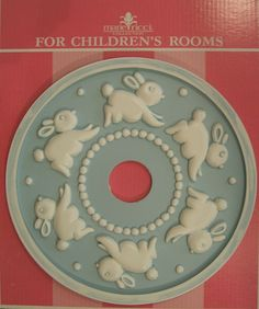 Kids Ceiling Medallions by Marie Ricci. Bunny ceiling medallion shown in distressed powder blue. www.mariericci.com