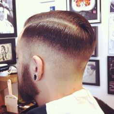 Medium fade, sharp part, slicked