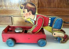 The Coaster Boy, made for only one year, is one of Fisher Price's rarest and most sought-after lithographed wooden pull toys the coaster features an attached, jointed wooden boy. Jouets Fisher Price, Fisher Price Toys, Vintage Fisher Price, Retro Toys, Vintage Toys, Toy Wagon, 1980 Toys, Pull Along Toys, Toys Land