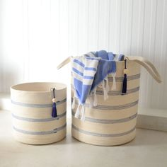 These stylish floor baskets are tall and come with long handles for easy carrying. They can be used to store a variety of things: laundry, blankets, towels, scatter cushions, etc. They can also be used in children's nurseries to store toys neatly.  Mia Mélange baskets are made from 100% cotton rope which we carefully sew together in a coiling technique. The cotton is grown locally in South Africa by farmers who are members of the Better Cotton Initiate (BCI). Large Baskets, Scatter Cushions, Cotton Rope, Nurseries, Farmers, South Africa, Towels, Blankets, Laundry