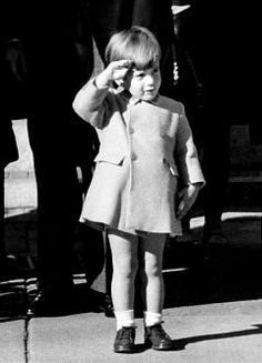 Three-year-old John F. Kennedy, Jr. salutes the coffin of his assassinated father, U.S. President John F. Kennedy, outside St. Matthew's Cathedral in Washington, D.C. after the elder Kennedy's funeral.