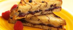 4 ounces Wisconsin mascarpone cheese 2 tablespoons dulce de leche 1/2 teaspoon pure vanilla extract 2 tablespoons butter, softened 8 slices cinnamon raisin bread 2 tablespoons raspberry preserves