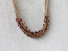 Linen necklace crocheted with brown opaque by 100crochetnecklaces