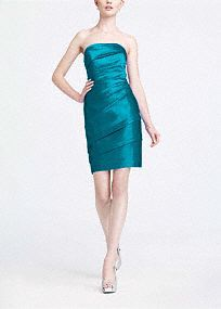 TyShyla's Choice: Simple yet stunning, this strapless satin style is a great go-to for your bridesmaids or any special occasion!  Flattering pleating all along the bodice and through the waist adds dimension while shaping a slimming silhouette.  Strapless neckline is sophisticated and elegant.  Rich satin fabric looks great in any light. Back zip.polyester. Dry clean only.   Get inspired by our colors.  Sizes and colors are available in limited stores and with limited avail…