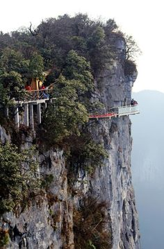 ft in the air, a glass walkway hugs the top of Zhangjiajie Tianmen Mountain (National Forest Park), China. There is no way in this world I could walk on this walkway! Zhangjiajie, Parc National, National Forest, Places To Travel, Places To See, Places Around The World, Around The Worlds, Glass Walkway, Travel Photos