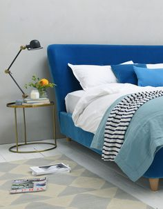 Like how the bedhead curves in at the sides - Loaf's Smoke bed with curving headboard in Azure blue velvet