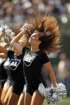 Oakland Raiders cheerleaders wear special shirts to honor Oakland Raiders owner Al Davis during their game against the Cleveland Browns at O.co Coliseum on October 16, 2011 in Oakland, California.