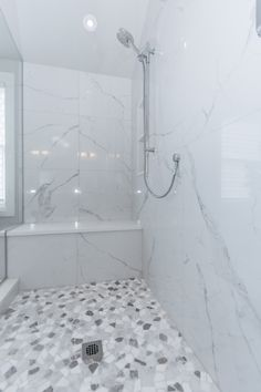 Classic marble look shower with the Mayfair Statuario Venato Polished tile with pebble shower floor Marble Tile Bathroom, Master Bathroom Shower, Modern Bathroom, Small Bathroom, Bathroom Showers, Bathroom Ideas, Shower Ideas, Washroom Tiles, 1920s Bathroom