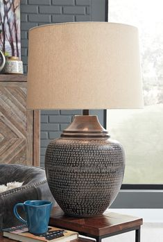Ashley Furniture Olinger Table Lamp with Made of antiqued finished metal with modified drum type A bulb (not included); 150 watts max or 25 CFL watts max; Brown Table Lamps, Large Table Lamps, Table Lamps For Bedroom, Metal Table Lamps, Living Room Lighting, Living Room Decor, Bedroom Decor, Dining Room, Farmhouse Table Lamps